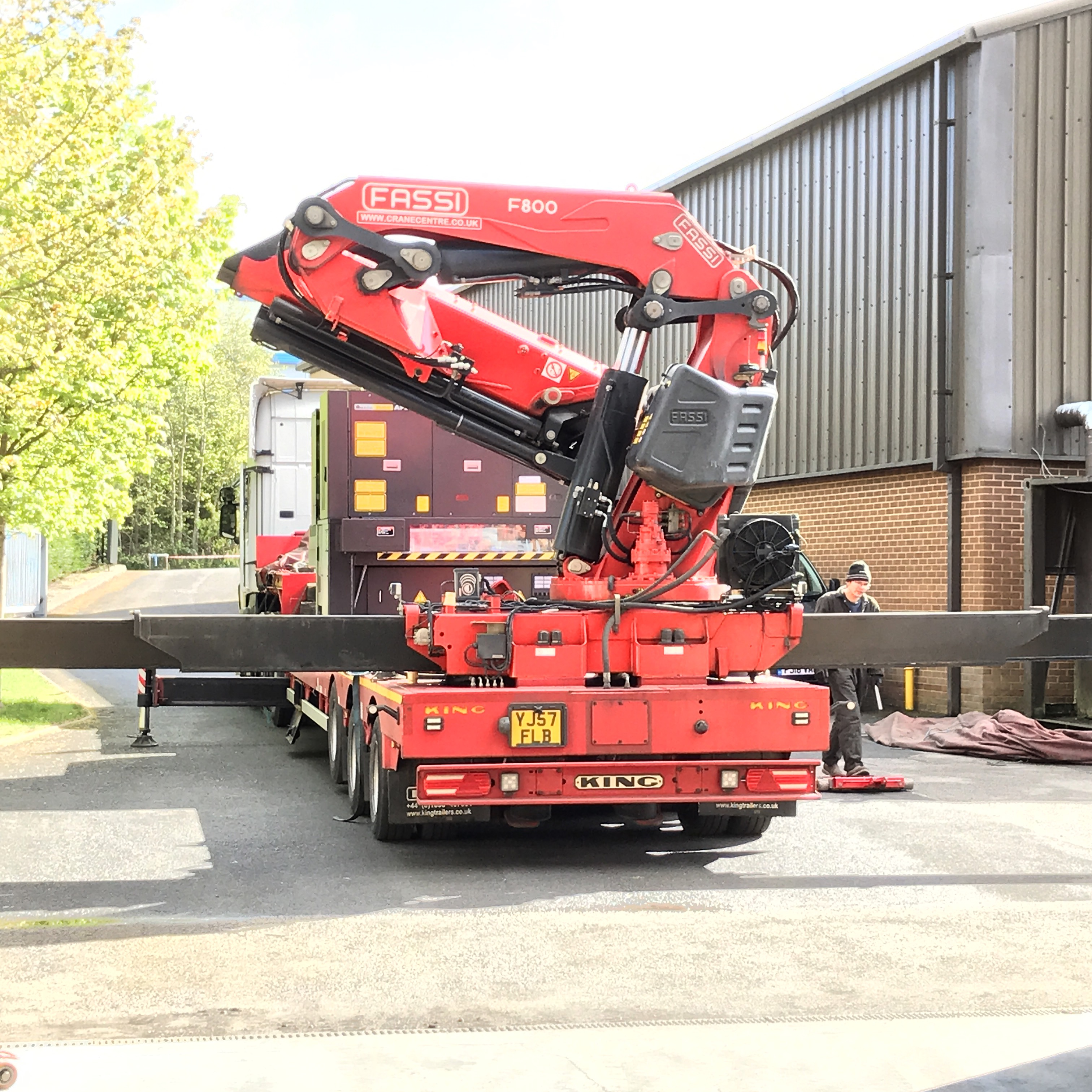 Laser cutting machine unloading off the lorry